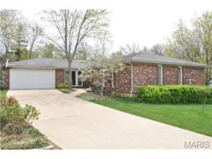 Mostly brick exterior with attached oversized 2 car garage with